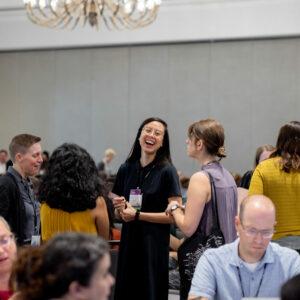 2019 DLF Forum attendees talking and laughing before keynote begins